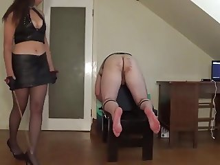 Miss Sultrybelle caning a sub.