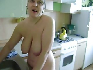 Russian naked wife at kitchen with daughter