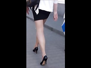 #31 Woman with sexy legs in mini skirt and stockings