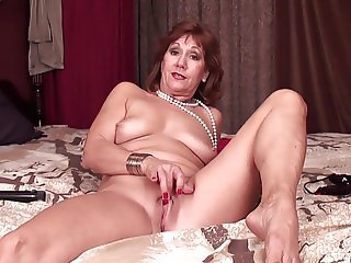 Mature Brook playing with skeleton and her shaved pussy