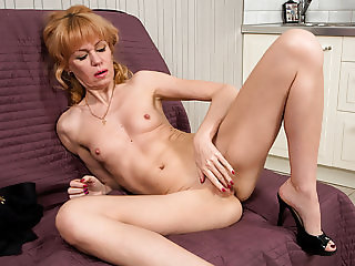 Small titted mommy fingering herself