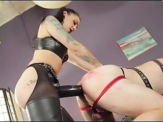 Big strapon dominatrix pounds her slave