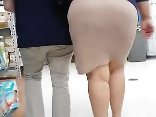 Candid Walmart mature worker in tight skirt and high heels.