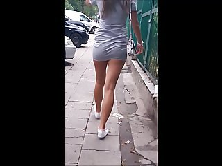 #48 Woman with sexy legs in grey minidress