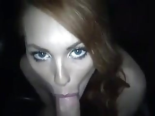 Beauty red head drinking cum