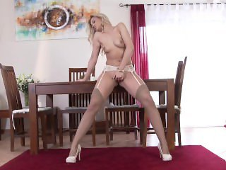 Beautiful blonde in tan stockings masturbatin