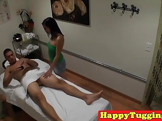 Asian masseuse jerking client on table