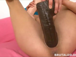 Sexy Laura Crystal gapes her pussy with a brutal dildo