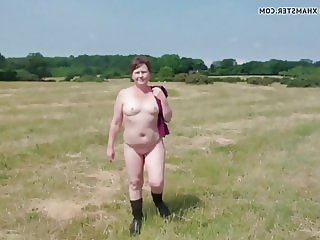 Small titted milf suzy walking nude in the field