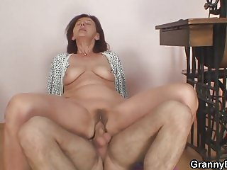 Older granny enjoys riding younger cock