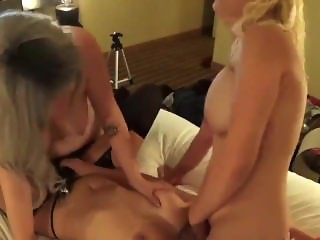 Three lesbians suck tits and strap on fuck.
