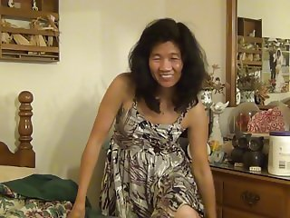Asian MIlfy shows her little tits