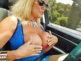 Slut flashing big tits while driving