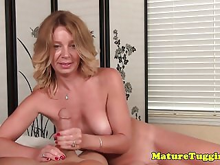Busty mature cougar jerking cock POV