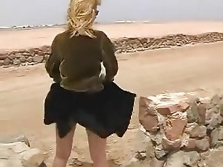 Windy day.Lets her skirt fly 02