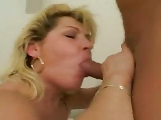 Hot mature with big tits fucks younger guy