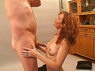 Redhead amateur Milf sucks and fucks at home