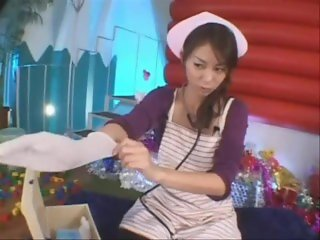 Japanese nurse in long surgical glove works prostate and milks patient
