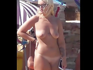 Blonde naturist shows her curvy natural body