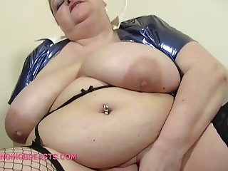 Fat Granny with Big Hanging tits screws herself