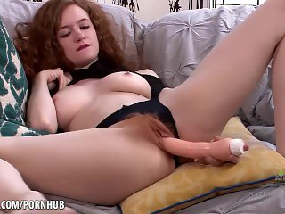 Hairy red head fucks herself with toy