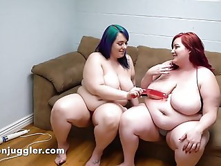 Two plump Lesbians playing with pussy