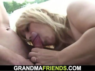 Blonde granma swallows two rods outside
