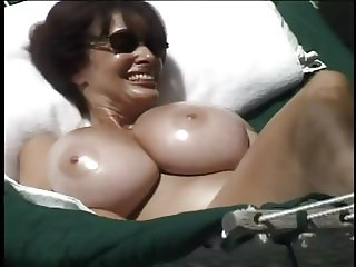 Huge heavy tits on a beautiful lady next to the pool