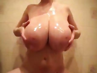 Big huge yummy boobs covered in oil