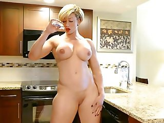 Hard body milf naked in the kitchen