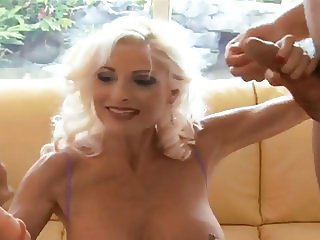 Blonde gilf takes on two cocks