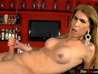 Perfect blonde t-girl strips off black lingerie and strokes
