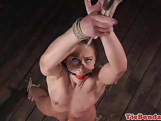 BDSM sub spreadeagled whipped and toyed