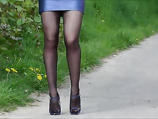 Nice sexy lady in blue tight leather mini skirt