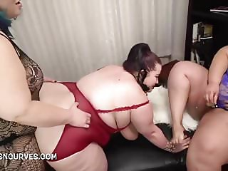 Supersized Lesbian double penetrated by 2 bitches
