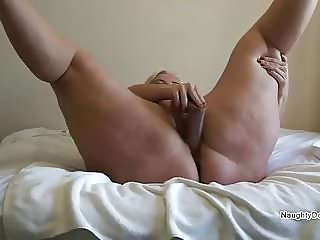 Desiree using a brown dildo to make her squirt