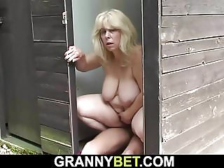 Blonde granny rides stranger's cock on public