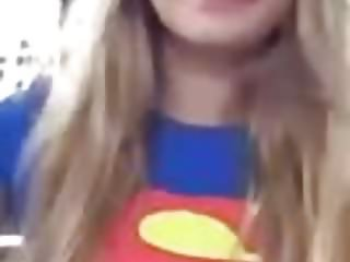 Trisha Annabelle smoking in superman outfit outside