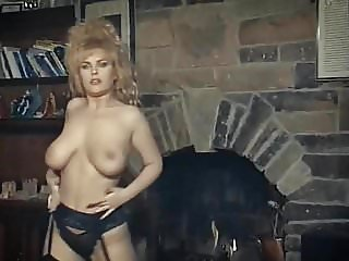 ROCK THIS WAY - big tits blonde strip dance tease