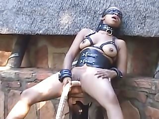 Black BDSM Sex Slave Playing with Dildo