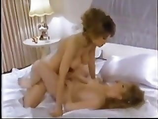 Christy Canyon fun lesbian sex with another busty 80s slut