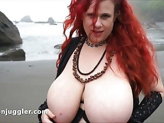 Redhead with enormous tits on the beach