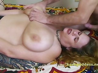 Using her tits and mouth to make him hard