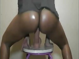 A black in the fleshy bottom impales itself on a gigantic di