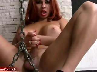 Kinky redhead shemale reveals lovely boobs and squirts jizz