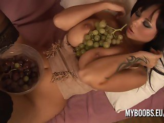 Busty babe Dominno with grapes