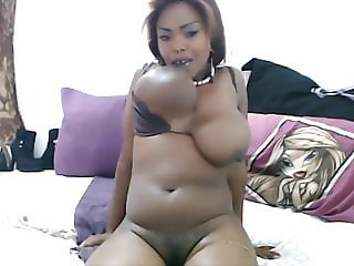 African sexy black panter plays with lactating big tits
