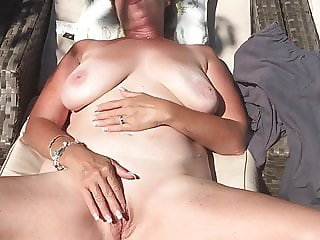 Sunbathing nude masturbation
