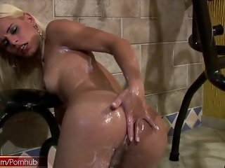 Blonde tgirl pours milk down her tasty tits and fingers ass