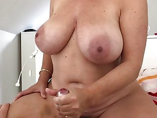 Big boobed milf gives handjob